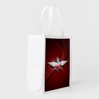 O coração tem as asas sacolas reusáveis