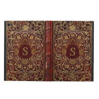O couro velho dourou o monograma da capa do livro