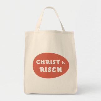 O cristo é aumentado, o bolsa vermelho do ovo