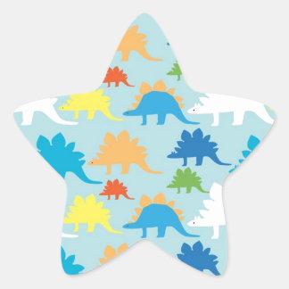 O dinossauro projeta dinossauros azuis do vermelho adesito estrela