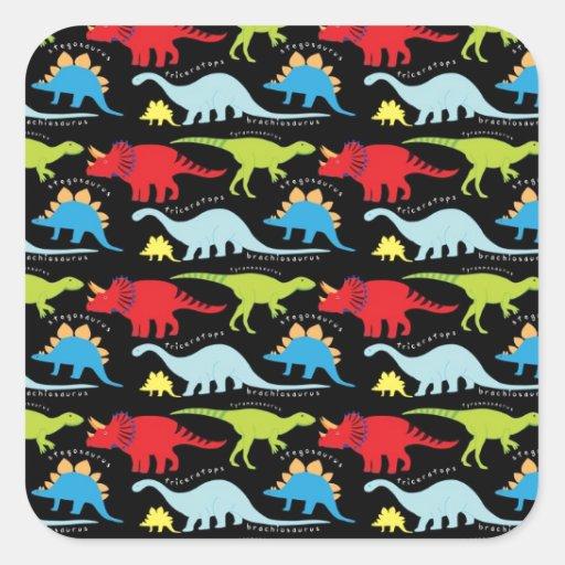 O dinossauro projeta o verde do vermelho azul no adesivo quadrado