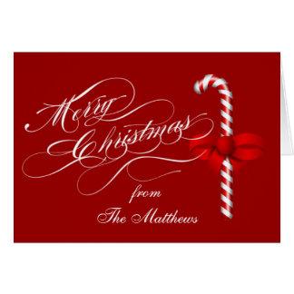 O Feliz Natal dobrou o bastão de doces do cartão