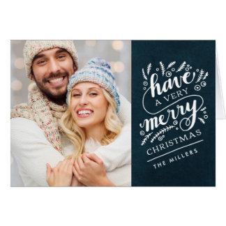 O Feliz Natal entrega cartão indicado por letras