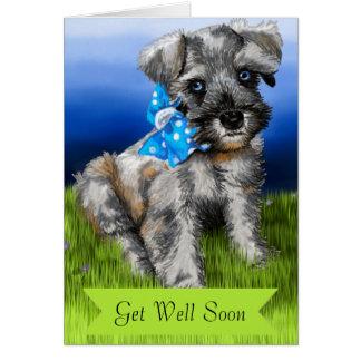 O filhote de cachorro do Schnauzer com obtem bem Cartão