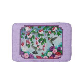 O fúcsia cor-de-rosa dos colibris floresce a tapete de banheiro