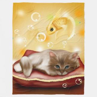 O gatinho sonha a cobertura do velo cobertor de velo