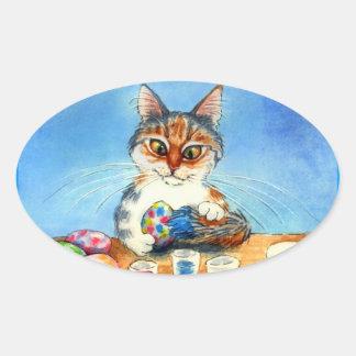 O gato pinta ovos da páscoa com etiqueta do oval d adesivos em formato oval
