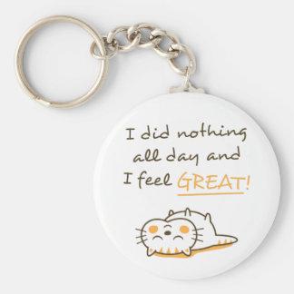 O gato preguiçoso bonito do gatinho não faz nada o chaveiro