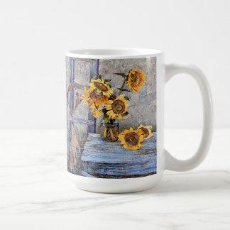 O girassol do verão floresce a caneca floral