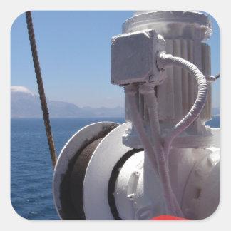 O guincho e a costa africana do navio adesivo quadrado