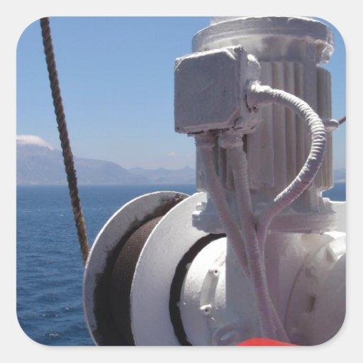 O guincho e a costa africana do navio adesivo em forma quadrada