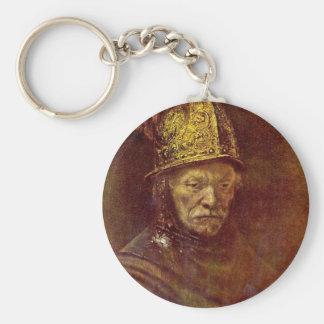 O homem com o capacete dourado chaveiros