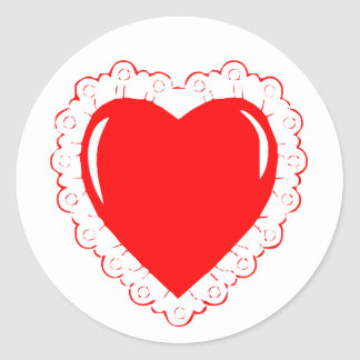 O laço afiou o coração vermelho adesivo
