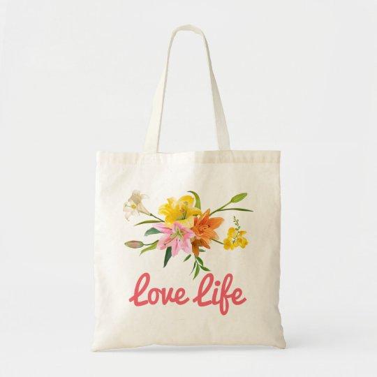O lírio floral da atitude floresce o rosa, bolsa tote
