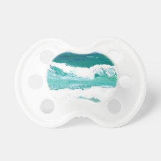 O mar de dança do oceano das ondas acena presentes chupeta para bebê