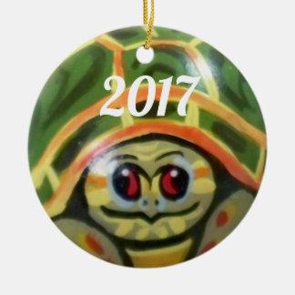 O ornamento verde da tartaruga do bebê caçoa a