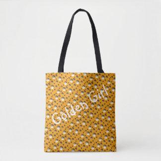 O ouro chique pontilha o saco para a praia ou a bolsa tote
