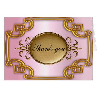 O ouro e os cartões de agradecimentos cor-de-rosa