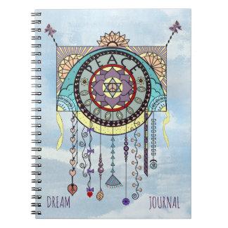 O papagaio dos símbolos de paz oscila o jornal cadernos espiral