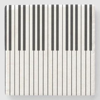 O piano fecha o marfim branco e preto porta-copo de pedra