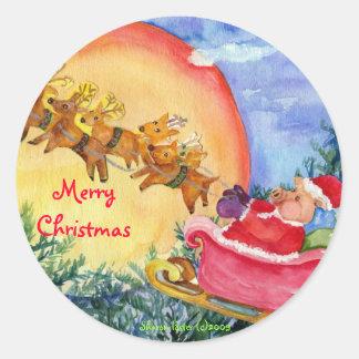 O porco do papai noel do Feliz Natal entrega o Adesivo Redondo
