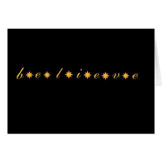 o preto e o ouro acreditam o cartão das estrelas