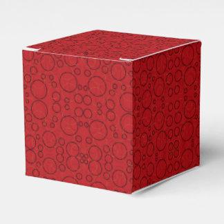 o preto vermelho circunda a caixa de presente