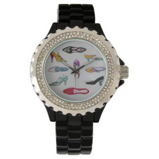 O relógio com vintage calça o motivo