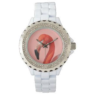 O relógio da mulher cor-de-rosa da cara do
