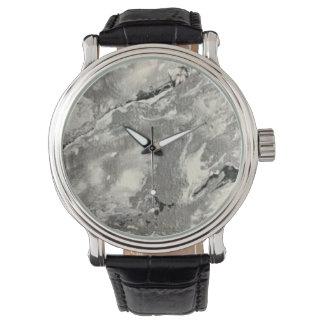 O relógio de pulso do homem ou da mulher