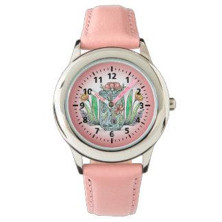 O relógio floral bonito da criança cor-de-rosa
