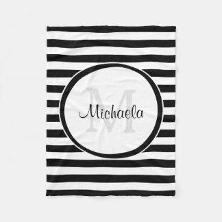 O toldo branco preto lustroso listra o nome cobertor de lã