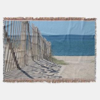 O trajeto de Sandy e a cerca da praia na raça Throw Blanket