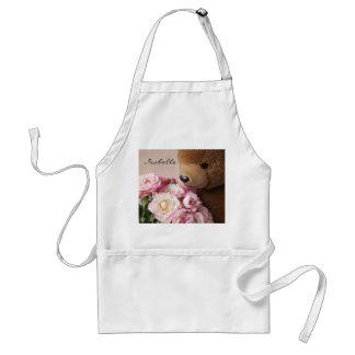 o urso de ursinho cheira o avental dos rosas