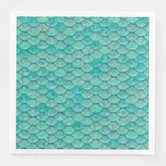 O verde de mar da sereia escala o guardanapo de