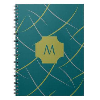 O verde e a cinza do monograma rodam na cerceta caderno