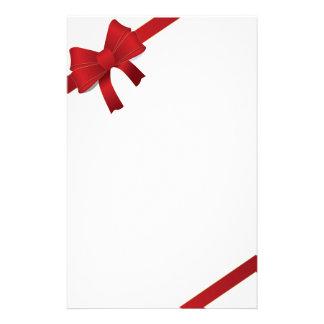 O vermelho curva artigos de papelaria do Natal