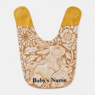 O vintage branco do ouro do babador do bebê do