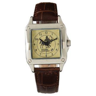 O zodíaco todo do Sagitário datilografa o relógio