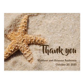 Obrigado estrela do mar no cartão da areia
