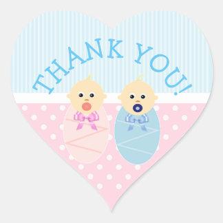 Obrigado junta etiquetas azuis e cor-de-rosa