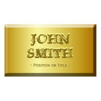 Olhar fino do tijolo do ouro com texto gravado cos cartão de visita