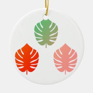 Ornamento acrílico com folhas exóticas