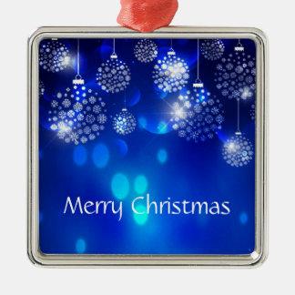 Ornamento brancos no Feliz Natal azul