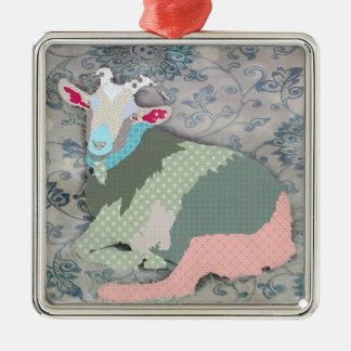 Ornamento da cabra dos remendos