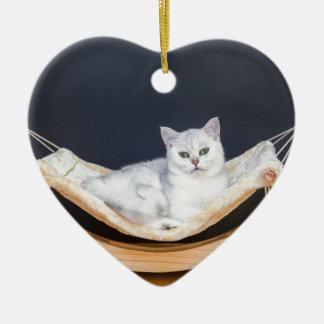 Ornamento De Cerâmica Encontro branco do gato preguiçoso no hammock
