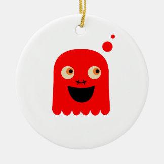 Ornamento De Cerâmica Monstro vermelho pequeno bonito no branco