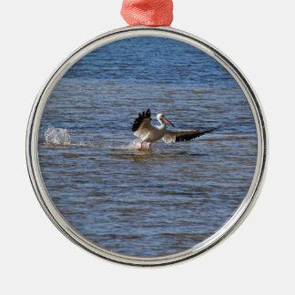 Ornamento De Metal Aterragem do pelicano