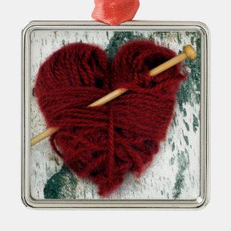 Ornamento De Metal Coração vermelho de lãs na fotografia do latido de