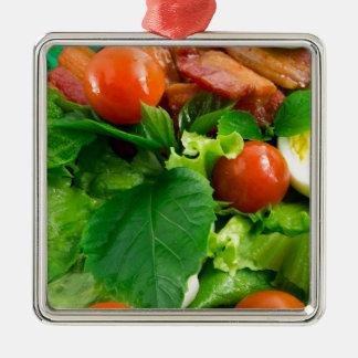 Ornamento De Metal Detalhe de uma placa com tomates de cereja, ervas